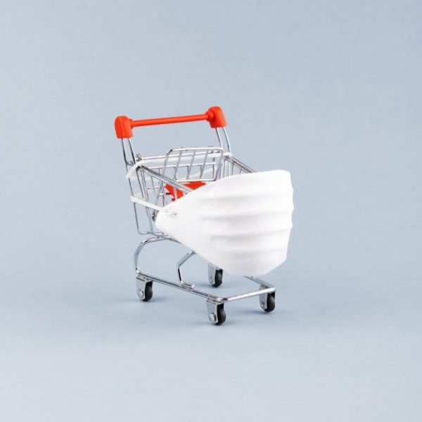 coronavirus-protection-concept-mini-grocery-cart-medical-face-shield-protect-yourself-with-mask-from-coronavirus-while-shopping_92695-774