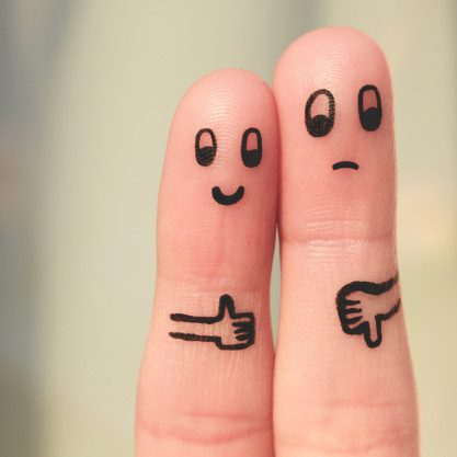 finger-art-couple-woman-showing-thumbs-up-man-showing-thumbs-down_104376-674