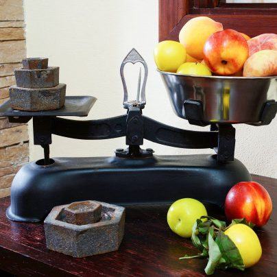 weighing-fruits-vintage-scales_103019-300